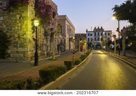KOS, GREECE - DECEMBER 10, 2016: Medieval fortification of the town and Italian architecture in Kos town, Greece on December 10, 2016.