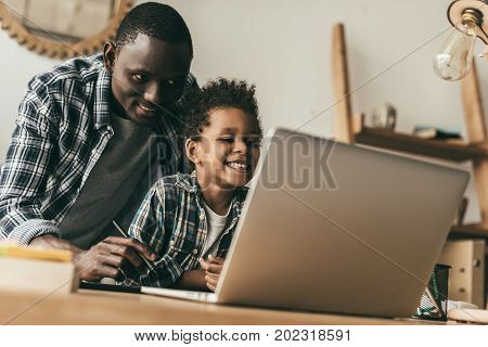 Father And Son Drawing With Tablet
