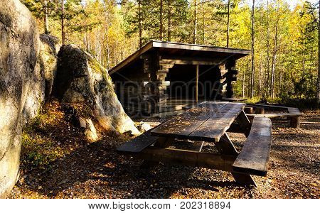 Forest hut and colorful nature background in Finland