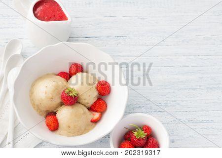 Vegan Banana Ice Cream With Strawberry Sauce And Fresh Strawberries
