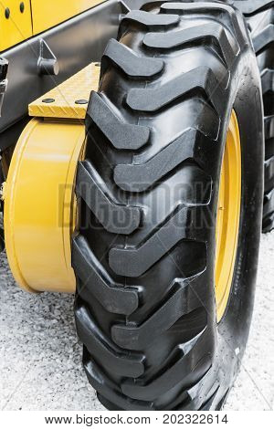 wheel of the tractor or other construction equipment large. focus on rubber wheels