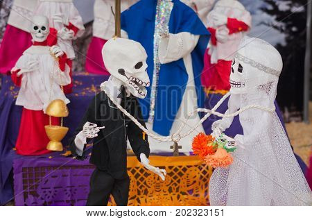 Mexican sculptures of a skeletons in Cathedral on Zocalo during the celebration of day of dead (Dia de los Muertos) Mexico City