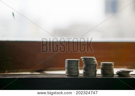 Stack Of Coin In Different Position. On The Edge Of Windows. Pile Of Coin On The Edge Of Windows Foc