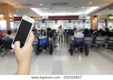Women Hand Holding Smart Phone To Call Relative To Wait While Waiting For Receive Medicine. Medical