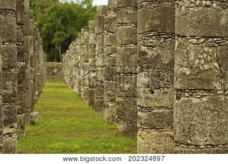 Columns in the Temple of a Thousand Warriors. Ruins of Chichen Itza pre-Columbian Mayan city Mexico