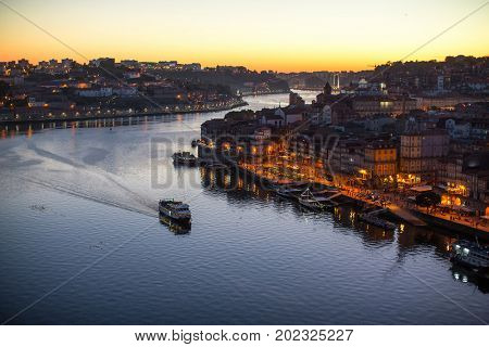 Douro river and Ribeira from Dom Luis I bridge at night time, Porto, Portugal.