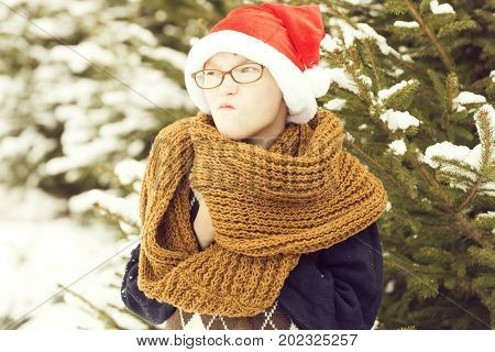Small Naughty Santa Boy In Winter Outdoor