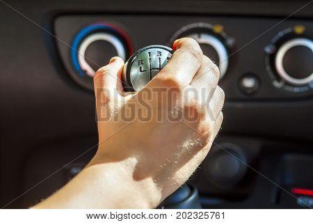 Driver hand shifting gear shift knob manually selective focus