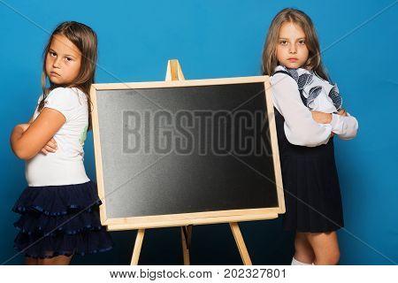 Children With Hands Crossed, Copy Space. Girls In School Uniform