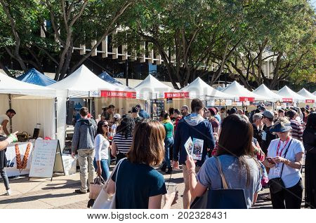 Brisbane, Australia - July 9, 2017: people and exhibition booths at the French festival on the South Bank of the Brisbane River.