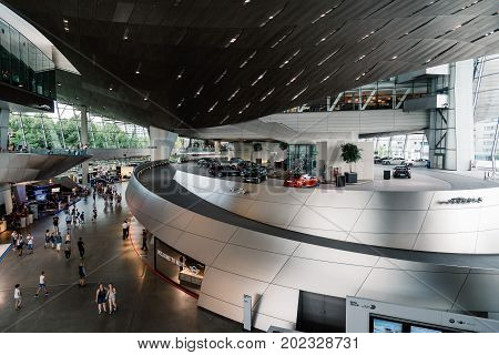 Munich, Germany - August 3, 2017: Interior shot of BMW Welt in Munich. It is a multi-use exhibition center used for meetings and promotional events, and where buyers take delivery of BMW vehicles. Designed by archtectural firm Coop Himmelblau