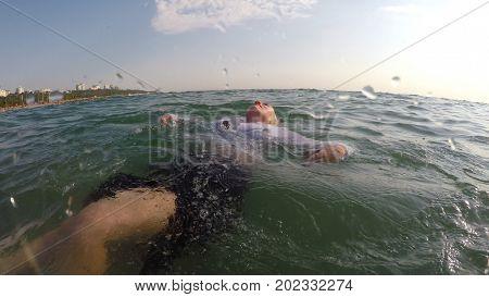 businesswoman swim in the sea