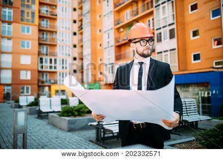 Architect On Construciton Site Check Documents And Business Workflow On New Building Outdoor