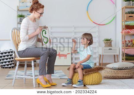 Boy Practicing Correct Pronunciation