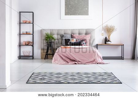 Bright Bedroom With Copper Elements