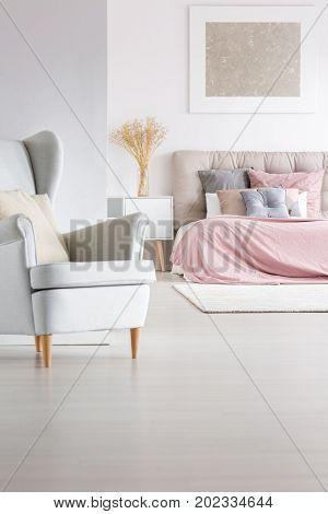Grey Armchair In Trendy Bedroom
