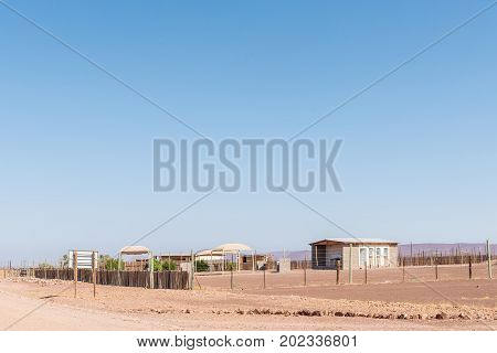 SPRINGBOKWASSER NAMIBIA - JUNE 28 2017: Camping sites and an ablution block at Springbokwasser at the Eastern gate of the Skeleton Coast National Park in Namibia