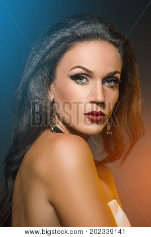 beautiful young woman portrait in Studio on dark background. Backlight