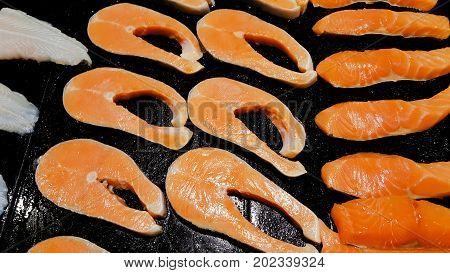 Sliced raw fatty salmon and background .