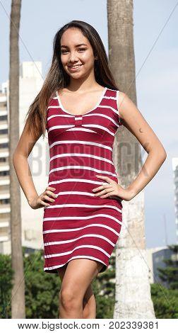 Hispanic Girl Standing Wearing a Striped Dress