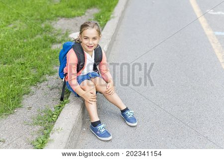 A eight years old school girl close to the schoolyards