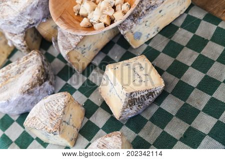 Dutch Blue Cheese Pieces Lay On The Table