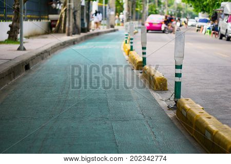Green And White Pole On The Green Road. Milestone Concept Such As The Way We Should Go Forward  Step