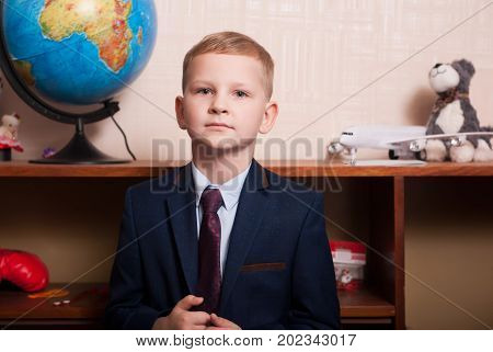 Young Blonde Boy Businessman Dressed In A Suit And Tie,