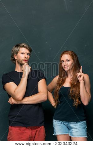 Young love Couple standing together at dark studio and remembering and thinking about something