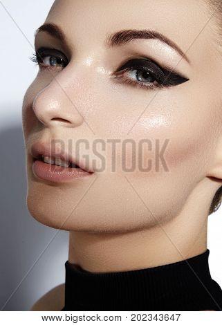 Glamourous Closeup Female Portrait. Fashion Eyeliner Makeup On Model Eyes. Cosmetics And Make-up. Se