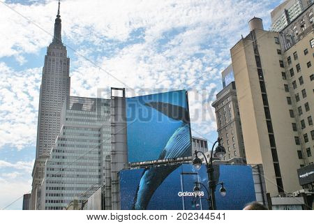New York City USA Empire State Building - June 21 2017 - a city view of the Empire State Building surrounded by other New York City buildings