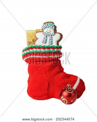 Christmas stocking with gingerbread cake gift and decoration isolated on white background