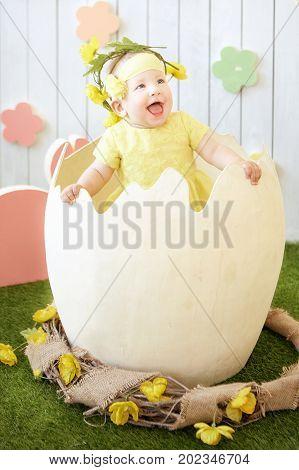 photo of little girl at the eggshell