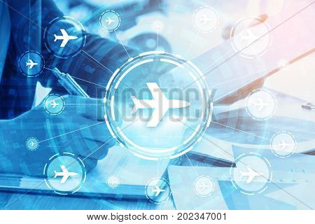 double exposure businessman writes business plan and flight travelling networking concept