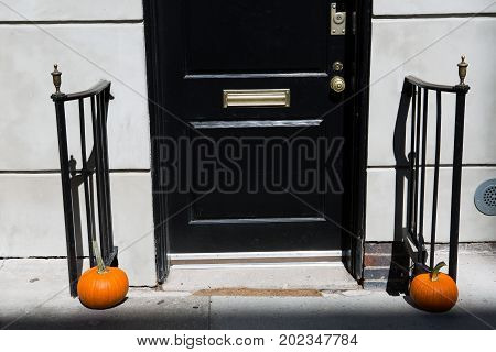 Halloween pumpkin at an entrance to a house