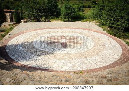 Round stone stage of greek outdoor theatre.