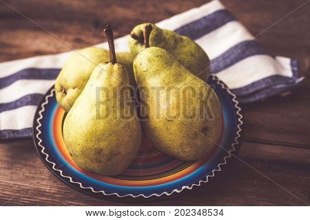 Williams pear on a wooden rustic background