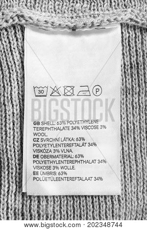Fabric composition and washing instructions clothes label closeup