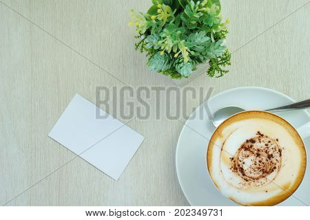 White Blank Business Card With Latte Art Coffee In White Cup And Small Plant On The Wooden Table In