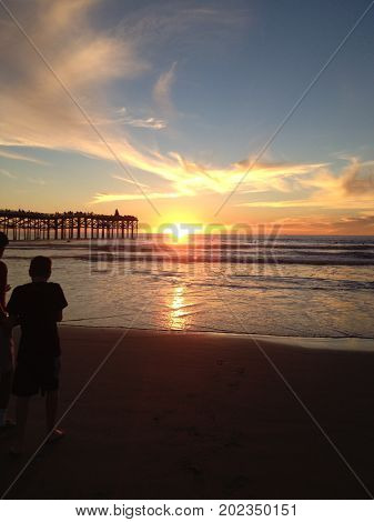 Crystal Pier, San Diego, California, Jan. 1, 2016. strolling the shoreline during first sunset of the year