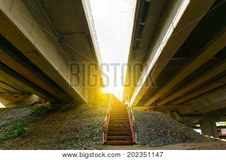 Success Concept. Metal Stair To Go Up To The Railway Track And Highway To See The Sky Above With Lig