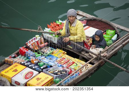 Ha Long Bay, Vietnam - March 12, 2017:  Floating vendor selling various fruits and snacks to tourists visiting Ha Long Bay