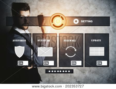 Businessman with smartphone standing on concrete background with digital antivirus screen. Guard concept