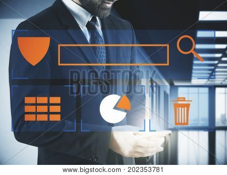 Close up of businessman hands using smartphone with abstract antivirus screen in blurry office interior. Defense concept