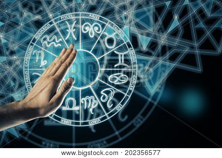 Hand with zodiac sign horoscope circle. Future and leo concept