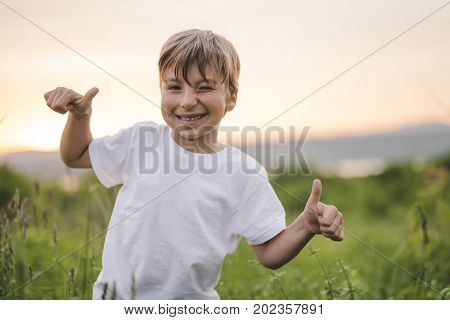 A nice and Happy boy in the meadow