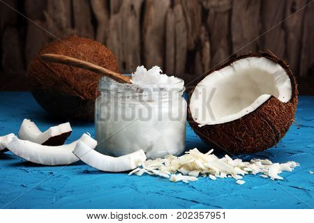 Coconut Oil And Fresh Coconuts On Blue Background