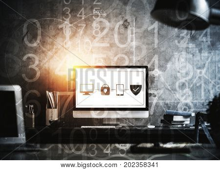 Abstract workplace with antivirus interface on computer screen abstract digits supplies and other items on concrete wall background. Internet concept