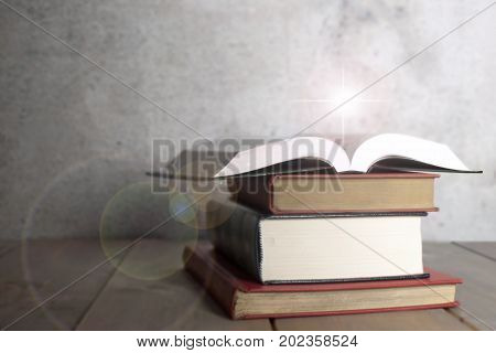 Open book on top of a stack with background space