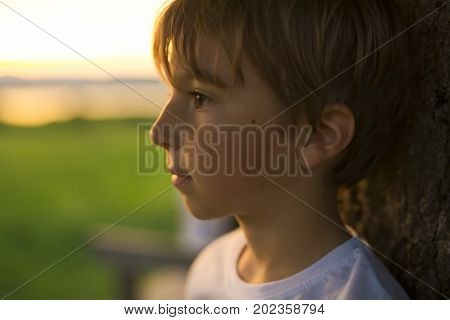 A Summer joy for cute kid at the backlit sunset